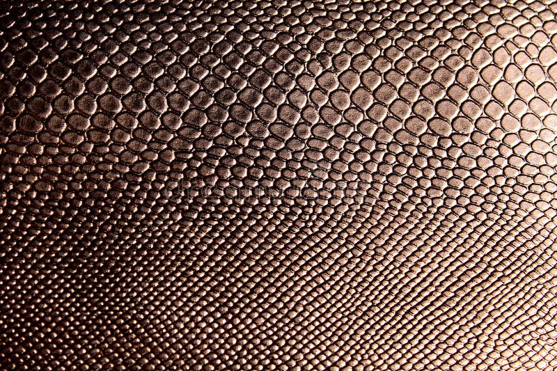 Texture of an artificial brown snake skin stock images