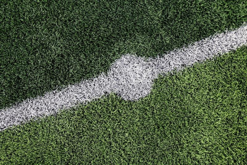 Artificial grass green texture of football field Small, top view artificial grass futsal ball field in gym indoor, Soccer sport fi royalty free stock images