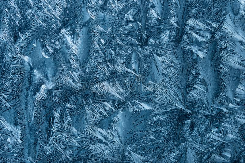 Texture of artificial ice crystals grown on glass surface. Close up shot of artificial ice crystals grown on glass surface royalty free stock photo