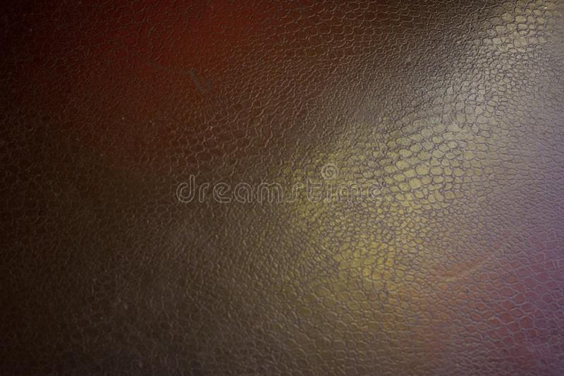 black leather background with pink and green highlight stock photography