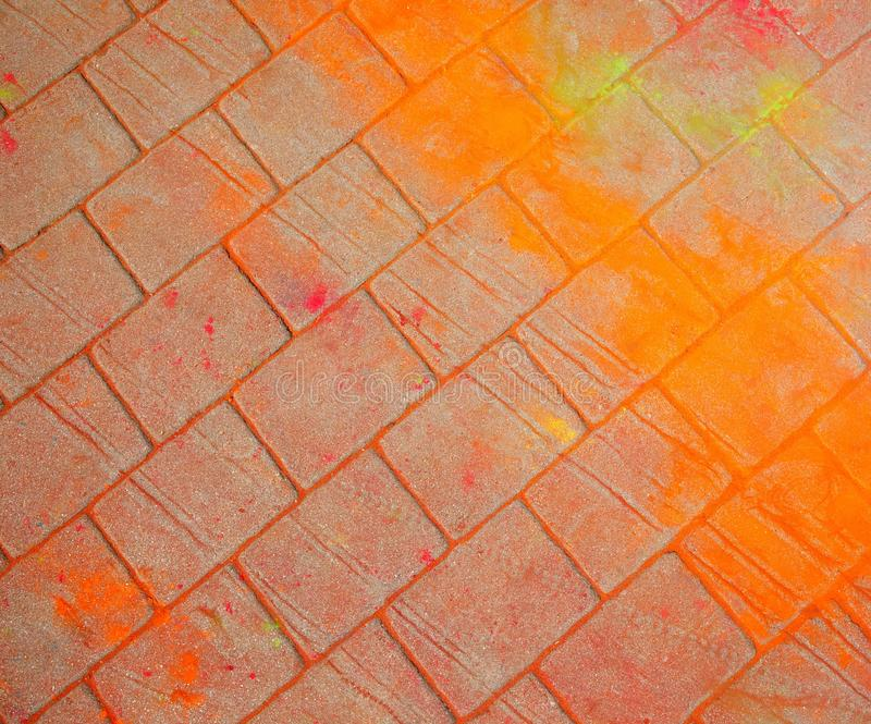 The texture of the asphalt. Multi-colored stains, splashes and traces of paint dry. stock images