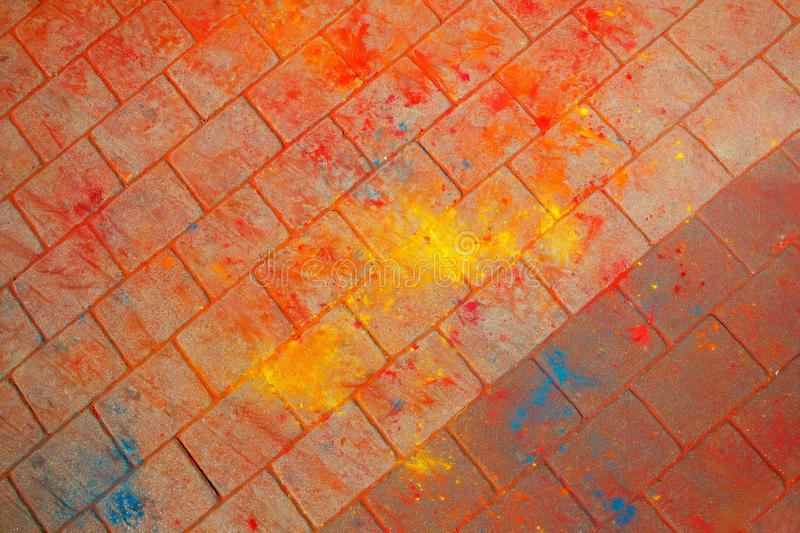 The texture of the asphalt. Multi-colored stains, splashes and traces of paint dry. The texture of the asphalt. Dry paint. Multi-colored stains, splashes and royalty free stock photos