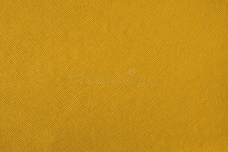 Texture avec un modèle d'une pluralité de lignes Fond jaune coloré photographie stock libre de droits