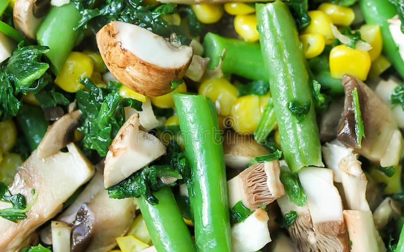 Texture and background of cut vegetables on a pan. Corn, spinach, asparagus, mushrooms close up royalty free stock photo
