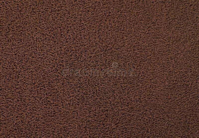 Texture Background of The Dark Brown Plastic Doormat. Background Pattern, Horizontal Texture of Dark Brown Plastic Doormat stock photo