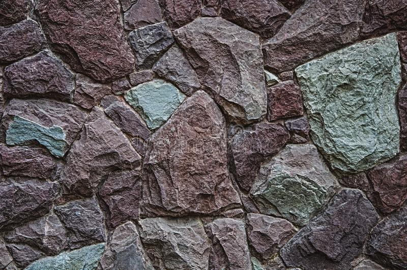 Texture and background of granite stone. Red and green color. royalty free stock image