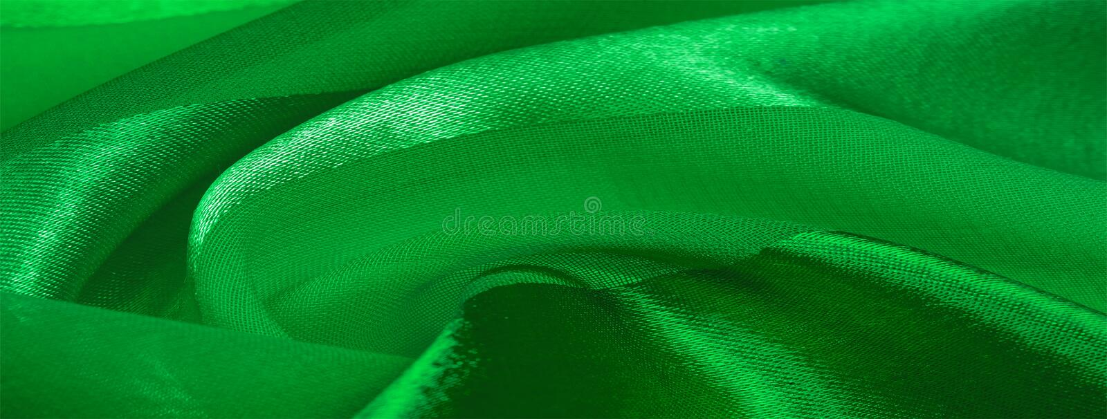 Texture, background, green silk striped fabric with a metallic sheen. If you have a bad mood, this fabric will lift it to. Unprecedented heights. Your project royalty free stock photo