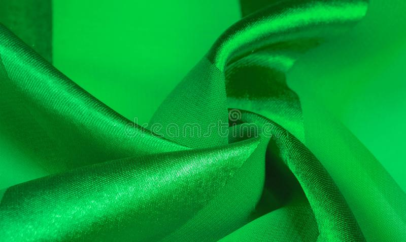 Texture, background, green silk striped fabric with a metallic sheen. If you have a bad mood, this fabric will lift it to. Unprecedented heights. Your project stock photo