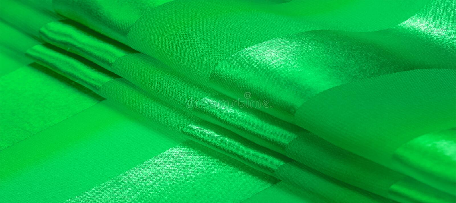 Texture, background, green silk striped fabric with a metallic sheen. If you have a bad mood, this fabric will lift it to. Unprecedented heights. Your project stock photography