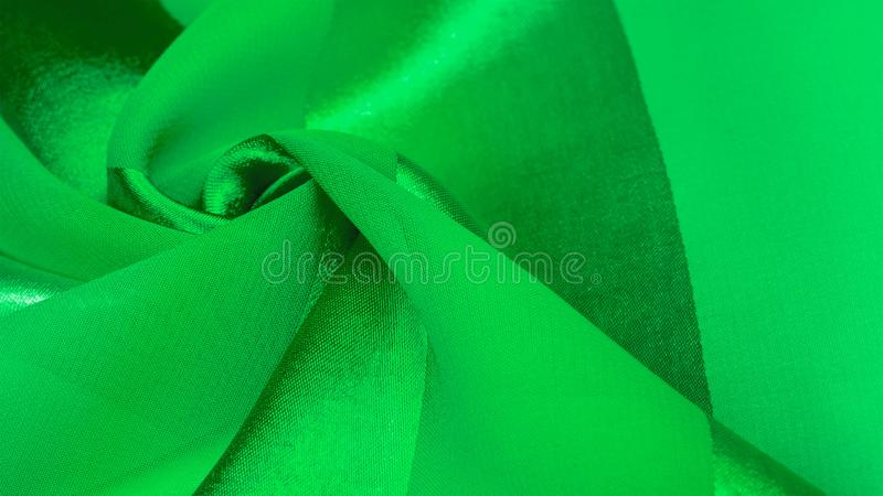 Texture, background, green silk striped fabric with a metallic sheen. If you have a bad mood, this fabric will lift it to. Unprecedented heights. Your project stock image