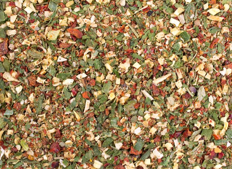 Texture background. Green spice mix dried vegetables and herbs. Spices consist paprika garlic onion parsnip celery coriander oregano pepper rosemary stock photography