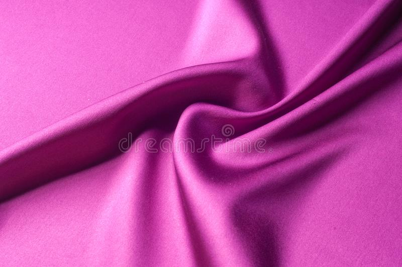 Texture of background image, Silk fabric of red color. satin or. Silk fabric as background royalty free stock images