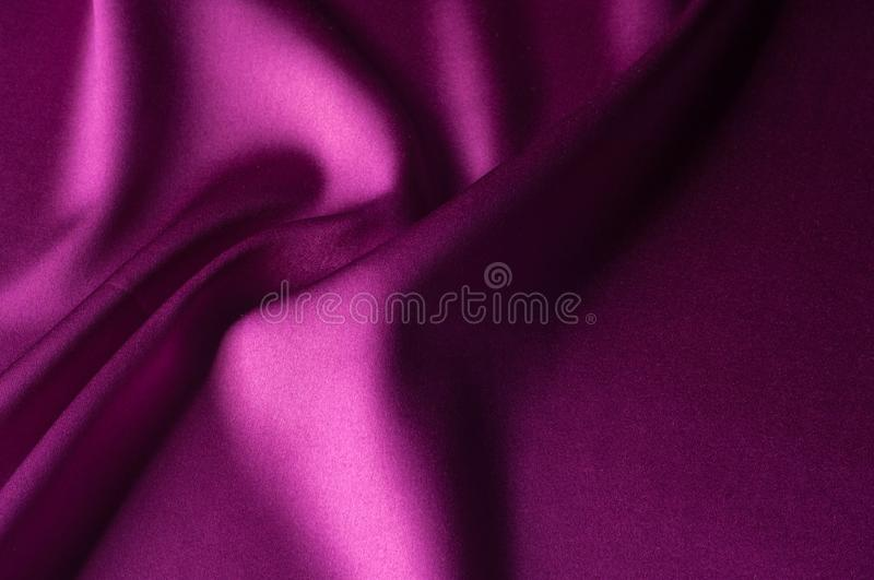 Texture of background image, Silk fabric of red color. satin or. Silk fabric as background stock image