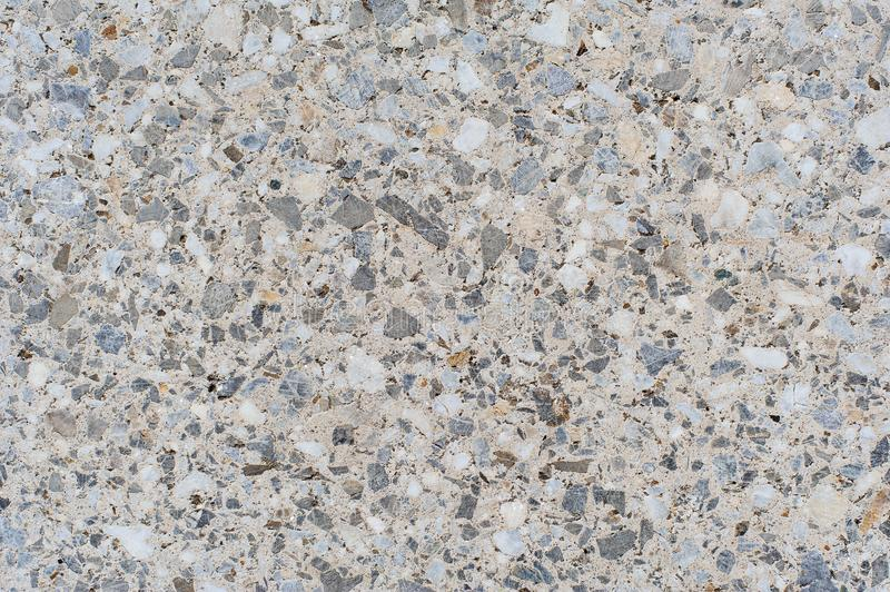 The texture background of a light granite tile interspersed with stone for design. Granite slab, marble texture royalty free stock photo