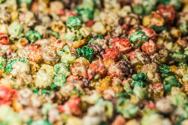 Texture background of multi-colored caramel popcorn. Close-up. stock image