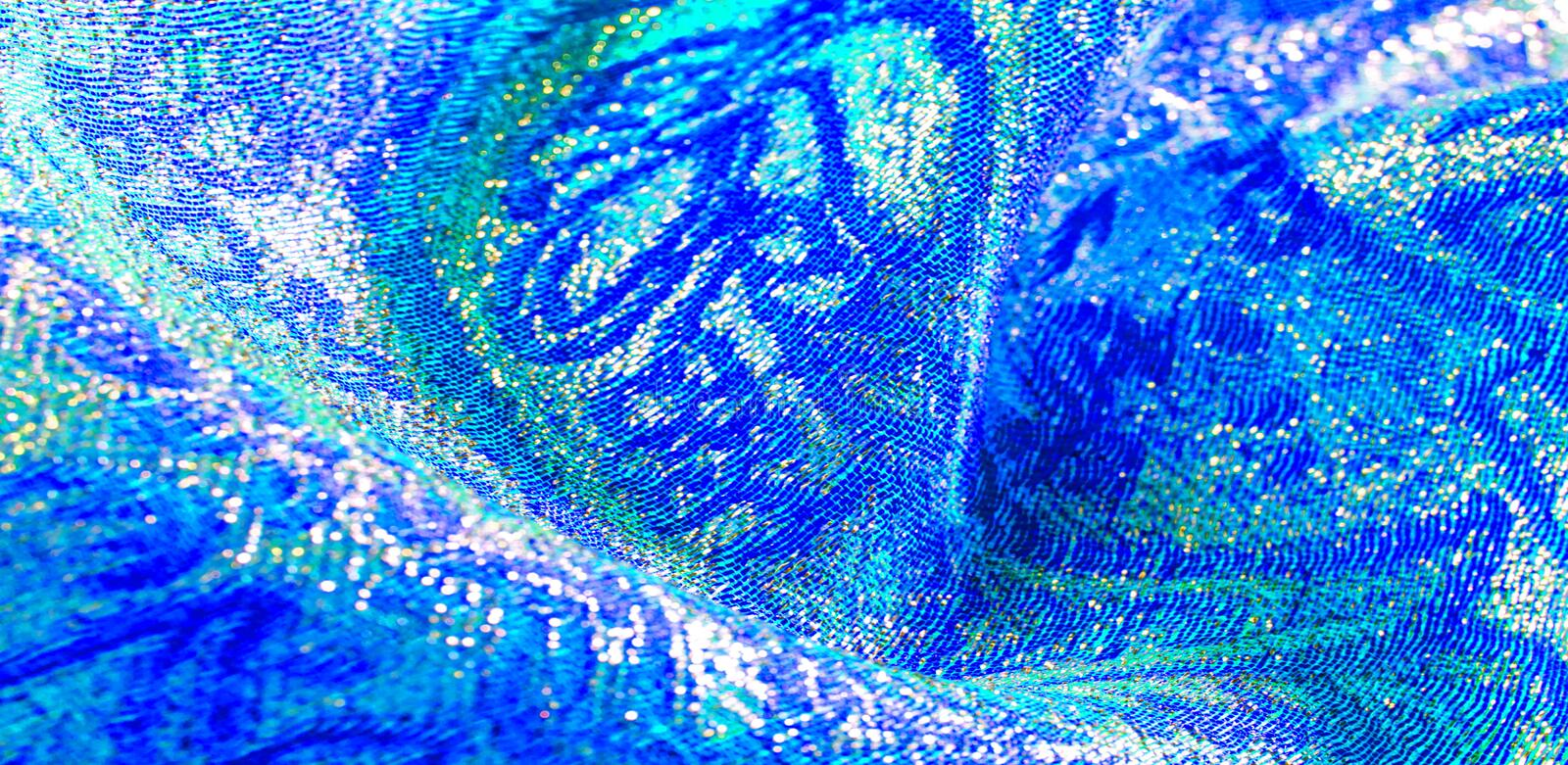 Texture background, pattern. blue brocade fabric. Organza brocade fabric - shepherd, with a crunchy palm. It has a large yarn-dyed. Flower embroidered pattern stock photography