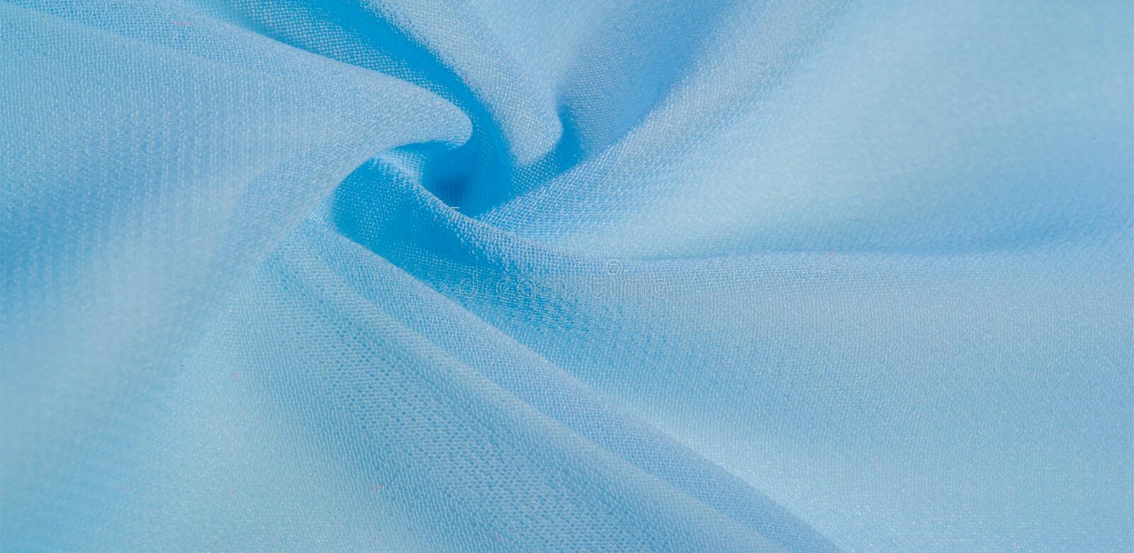 Texture background pattern. blue silk fabric This is a light artificial silk fabric of dupioni with a subtle matte sheen. It is. Perfect for your design royalty free stock photos