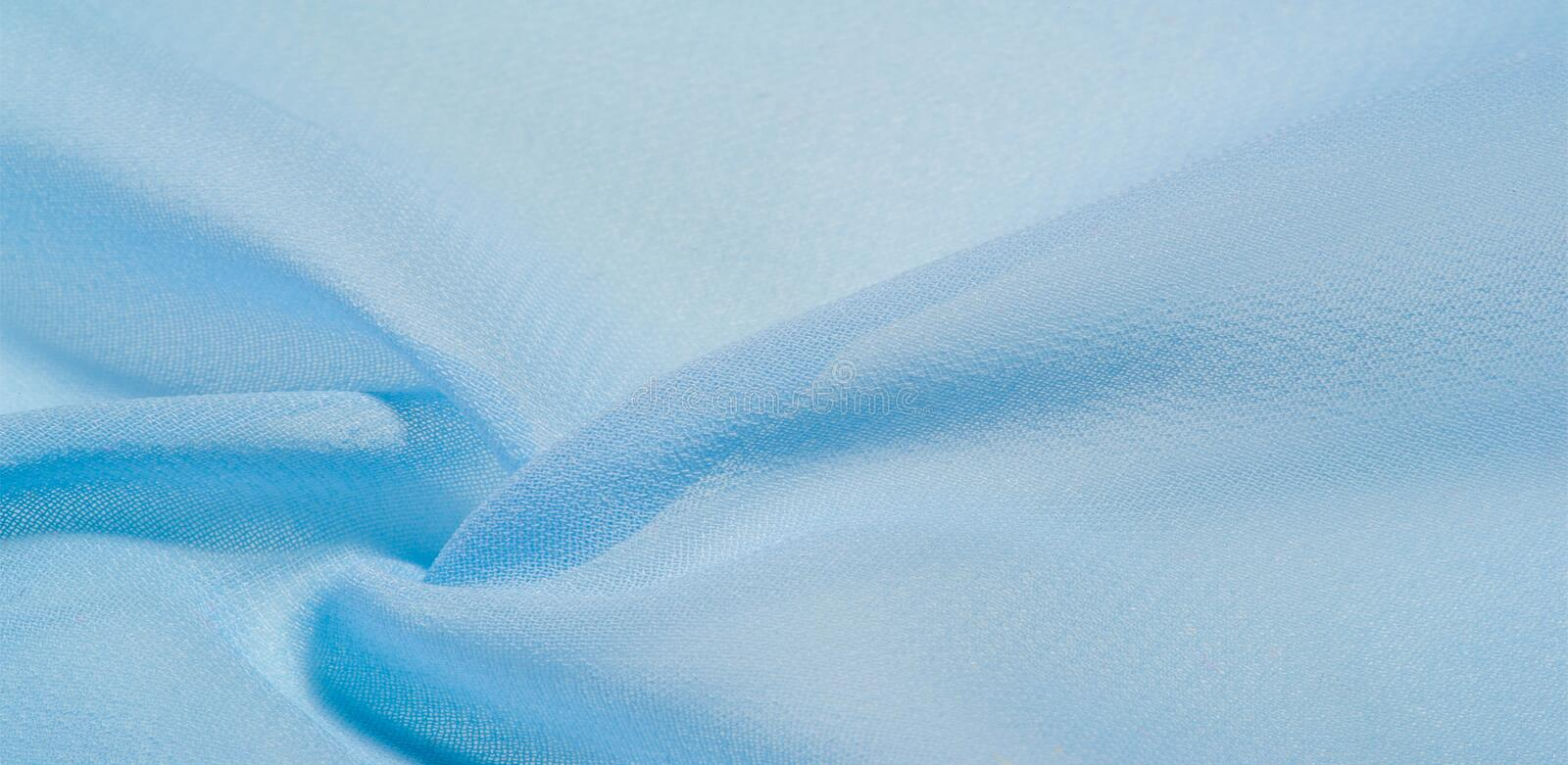 Texture background pattern. blue silk fabric This is a light artificial silk fabric of dupioni with a subtle matte sheen. It is. Perfect for your design stock image