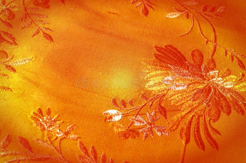 Texture background pattern. Brown embroidered with dense silk fa stock photography