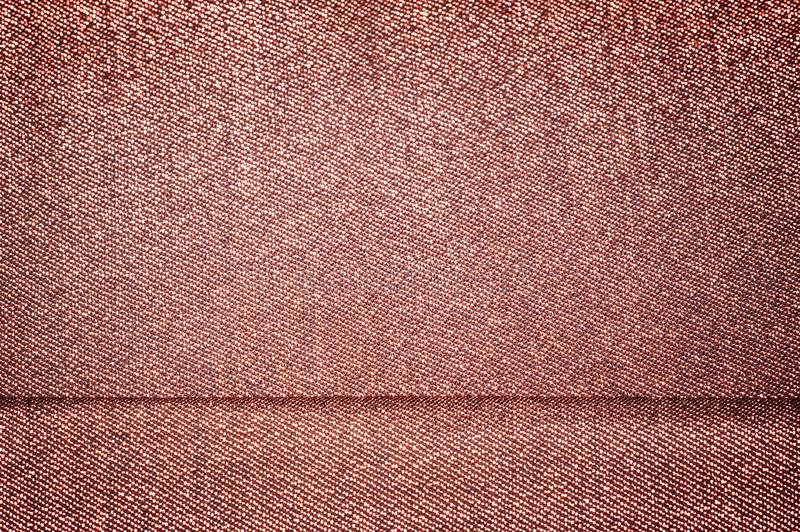 Texture, background, pattern. Cloth with burgundy coating with metallic gold thread. These fabrics are ideal for any project,. Wallpaper, all design solutions stock images