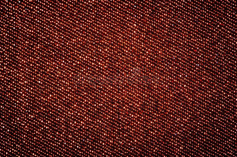 Texture, background, pattern. Cloth with burgundy coating with metallic gold thread. These fabrics are ideal for any project,. Wallpaper, all design solutions stock photos