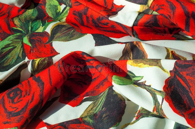 Texture, background, pattern. Cloth Silk Abstract Pattern. On th. E fabric are painted roses. Red roses on a white background stock images