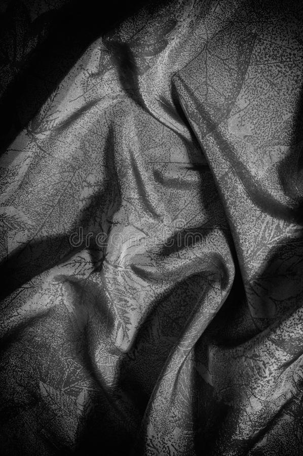 Texture, background, pattern. cloth silk black white. Look at th. E world through a quartz crystal with this black and white prismatic silk chiffon. Ultra soft stock photo