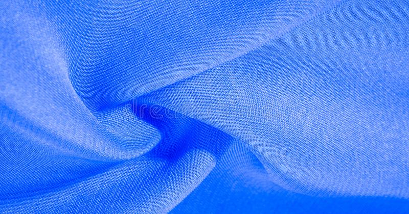 Texture, background, pattern, cyan blue, silk fabric This very lightweight artificial silk fabric has a pleasant sheen. Perfect. For adding elegance to your royalty free stock image