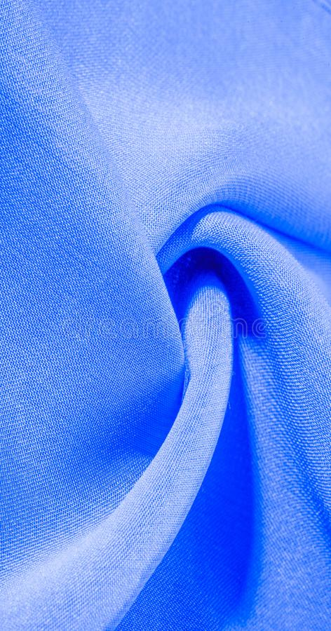 Texture, background, pattern, cyan blue, silk fabric This very lightweight artificial silk fabric has a pleasant sheen. Perfect. For adding elegance to your royalty free stock photo