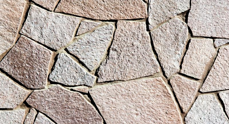 Texture background pattern. Granite stone, sandstone. finishing of buildings fences,  sedimentary rock, consisting of sand or stock photos