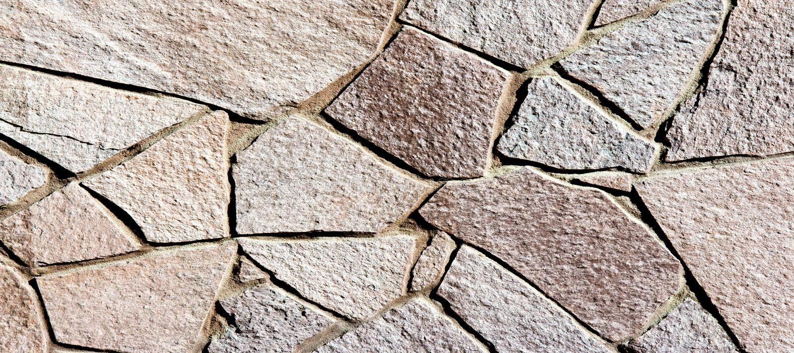 Texture background pattern. Granite stone, sandstone. finishing of buildings fences,  sedimentary rock, consisting of sand or royalty free stock image