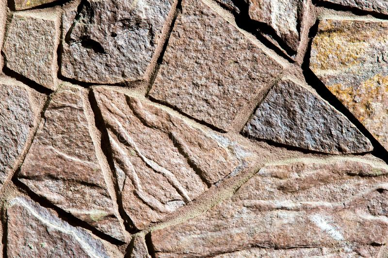Texture background pattern. Granite stone, sandstone. finishing of buildings fences,  sedimentary rock, consisting of sand or stock photography