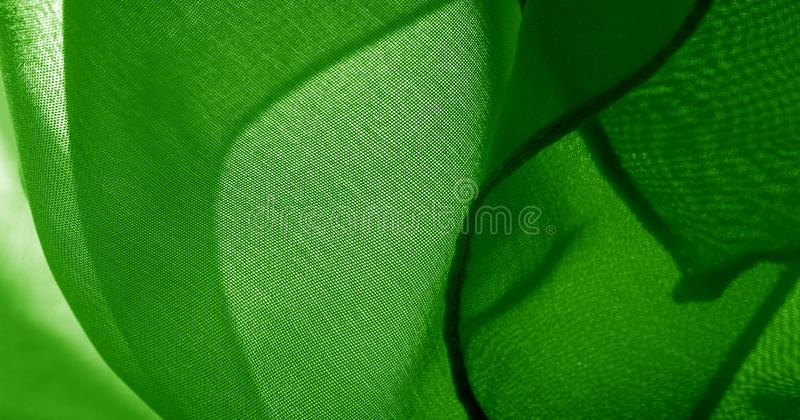 Texture, background, pattern, green salad, silk fabric This very lightweight fabric made of artificial silk has a pleasant sheen. Ideal for adding elegance to stock image