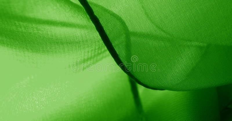 Texture, background, pattern, green salad, silk fabric This very lightweight fabric made of artificial silk has a pleasant sheen. Ideal for adding elegance to royalty free stock image