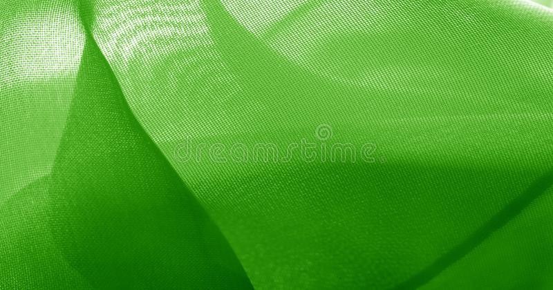 Texture, background, pattern, green salad, silk fabric This very lightweight fabric made of artificial silk has a pleasant sheen. Ideal for adding elegance to royalty free stock photos