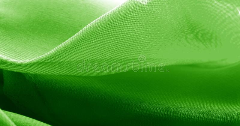 Texture, background, pattern, green salad, silk fabric This very lightweight fabric made of artificial silk has a pleasant sheen. Ideal for adding elegance to royalty free stock photography