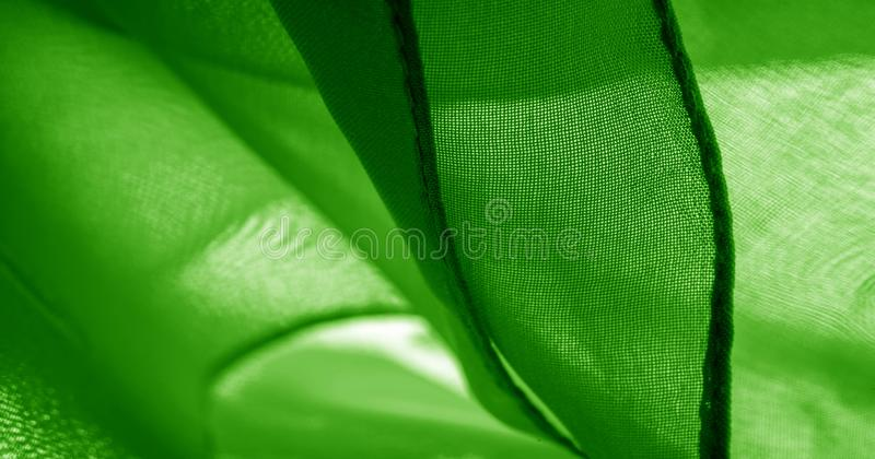 Texture, background, pattern, green salad, silk fabric This very lightweight fabric made of artificial silk has a pleasant sheen. Ideal for adding elegance to stock photo