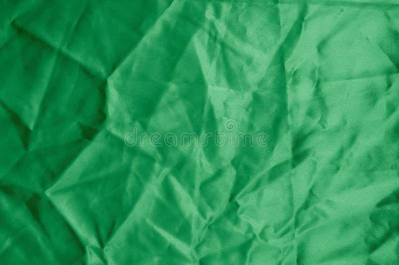 Texture, background, pattern. Texture of green silk fabric. Beau. Tiful emerald green soft silk fabric royalty free stock photo