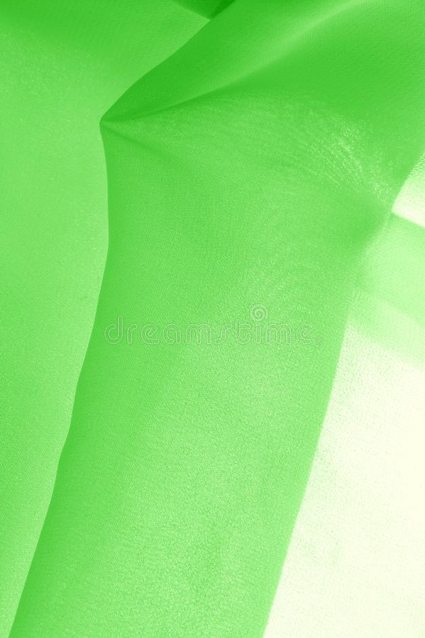 Texture background pattern. Green silk fabric with a subtle matte sheen. It is perfect for your design, accents, wallpapers,. Posters and postcards stock images