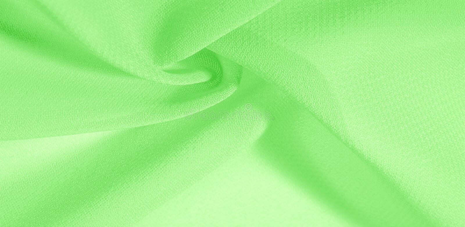 Texture background pattern. Green silk fabric with a subtle matte sheen. It is perfect for your design, accents, wallpapers,. Posters and postcards royalty free stock photos