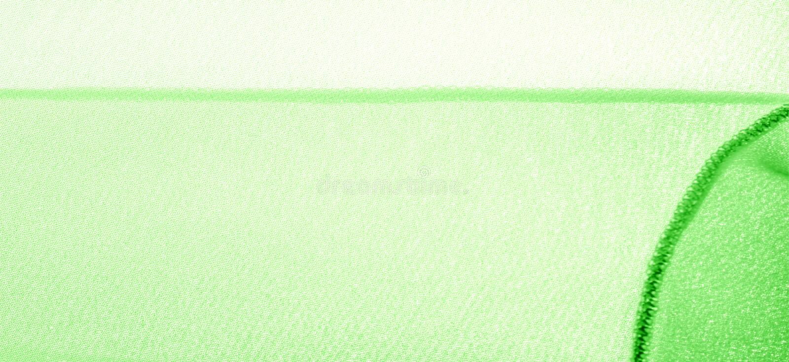 Texture background pattern. Green silk fabric with a subtle matte sheen. It is perfect for your design, accents, wallpapers,. Posters and postcards royalty free stock photography