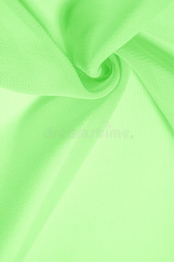 Texture background pattern. Green silk fabric with a subtle matte sheen. It is perfect for your design, accents, wallpapers,. Posters and postcards royalty free stock images