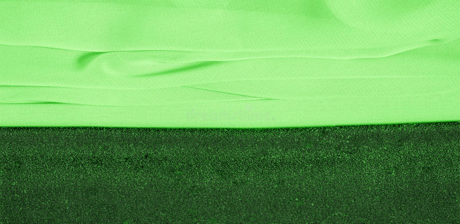 Texture background pattern. Green silk fabric with a subtle matte sheen. It is perfect for your design, accents, wallpapers,. Posters and postcards stock photography