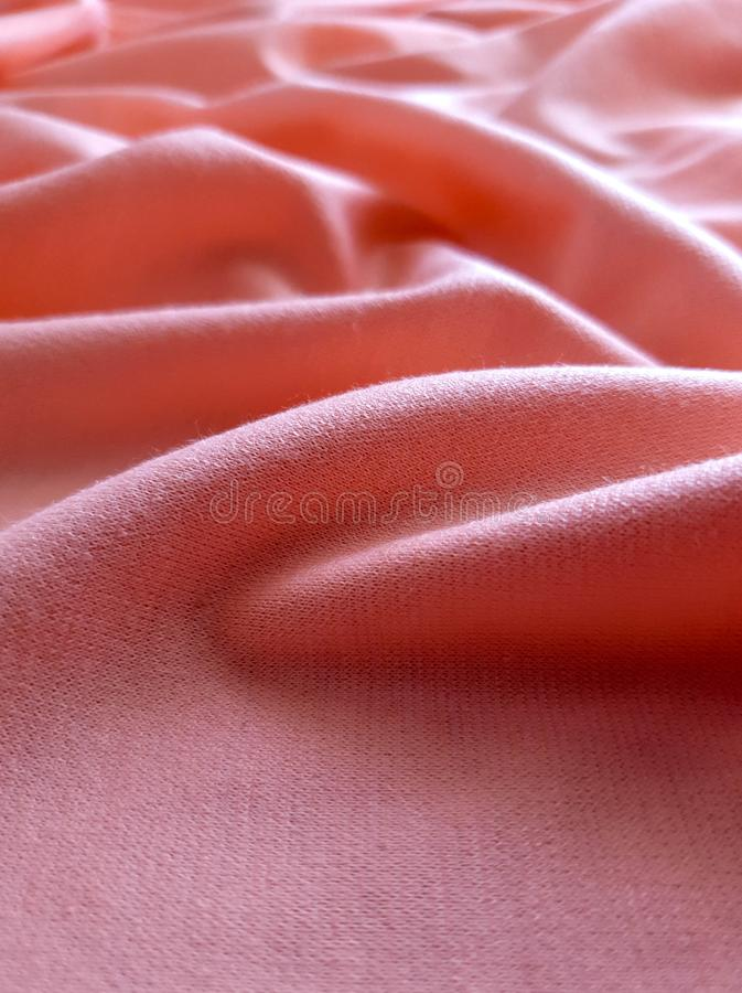 Texture, background, pattern, peach color soft cotton fabric. This linen can be used vertices, DIY projects, decor and stock images