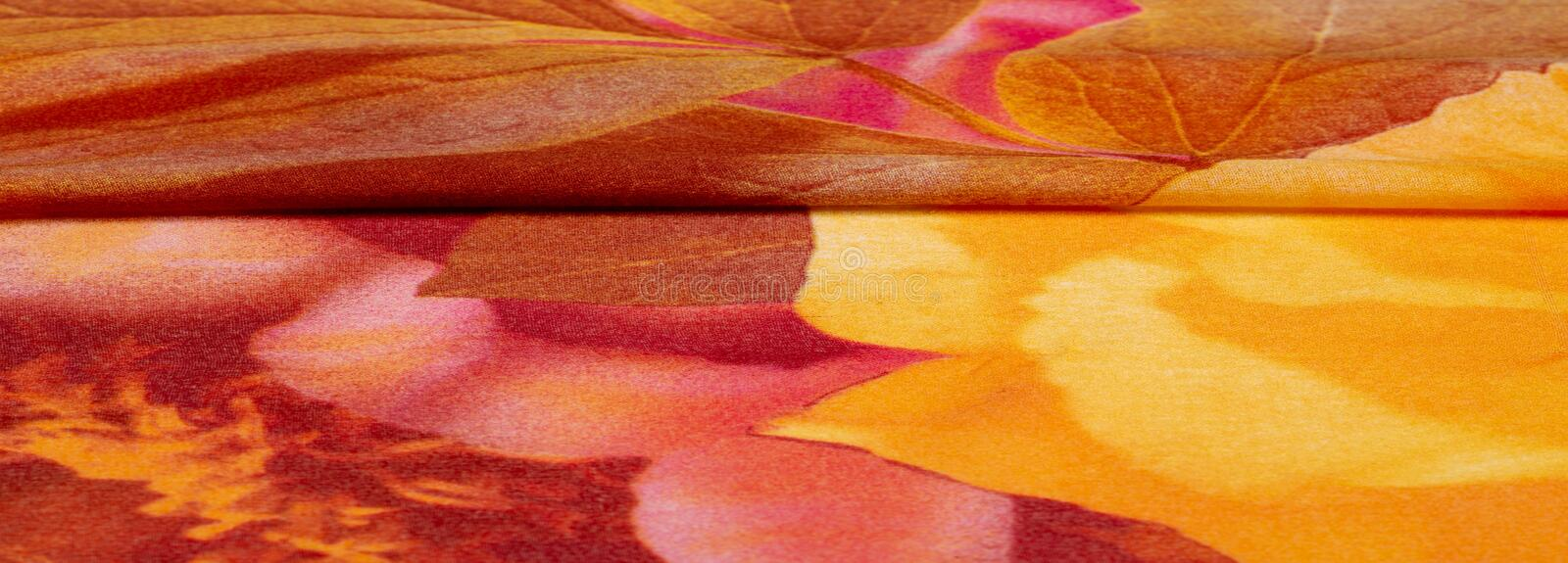 Texture, background, pattern, postcard, silk fabric, female color scarf with yellow red-brown colors. The gorgeous design is based. On attractive background vector illustration