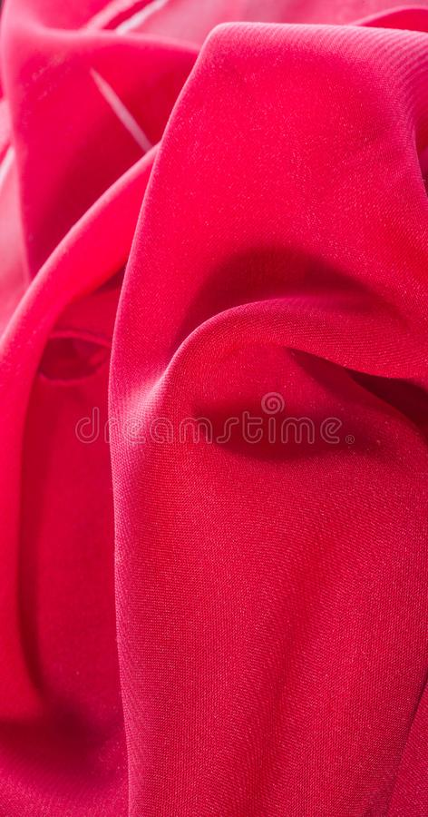 Texture, background, pattern, Red Crimson Silk Fabric This very lightweight rayon fabric has a nice sheen. Perfect for adding. Elegance to your internet decor stock images