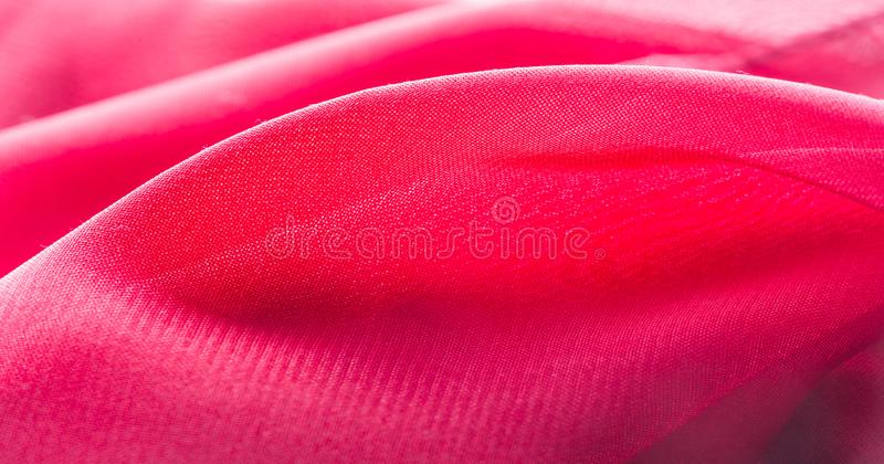 Texture, background, pattern, Red Crimson Silk Fabric This very lightweight rayon fabric has a nice sheen. Perfect for adding. Elegance to your internet decor stock photography