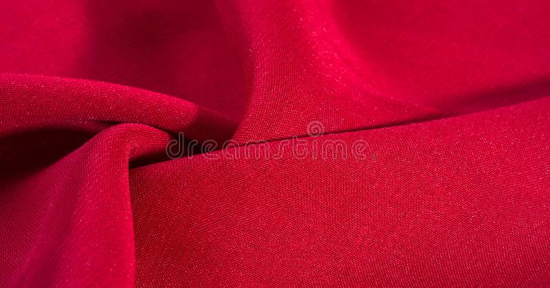 Texture, background, pattern, Red Crimson Silk Fabric This very lightweight rayon fabric has a nice sheen. Perfect for adding. Elegance to your internet decor stock photo