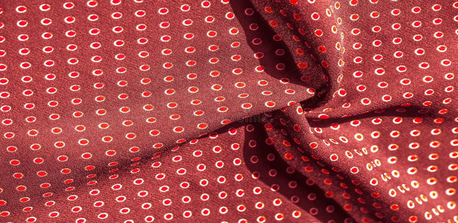Texture background, pattern, red silk fabric with red polka dots. Light and silky-soft satin pendant is perfect for your design,. Online projects. It is also stock photography