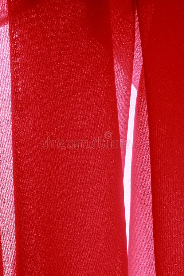 Texture background pattern. Red silk fabric with a subtle matte sheen. It is perfect for your design, accents, wallpapers, posters. And postcards royalty free stock photography